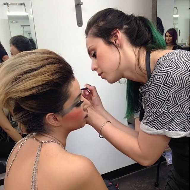 Irma doing makeup on her model for a school photoshoot.