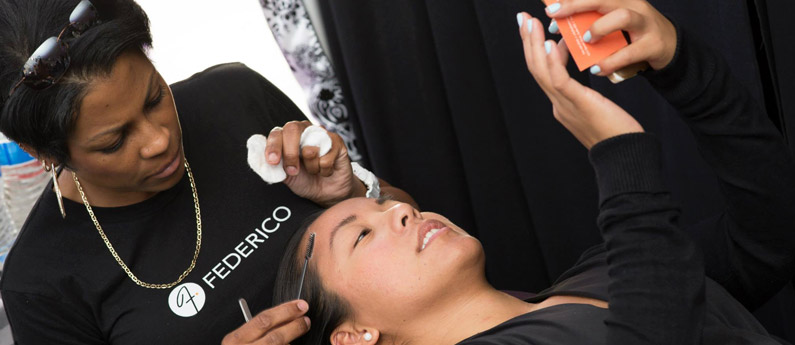 A Federico student takes care of a client in the student salon