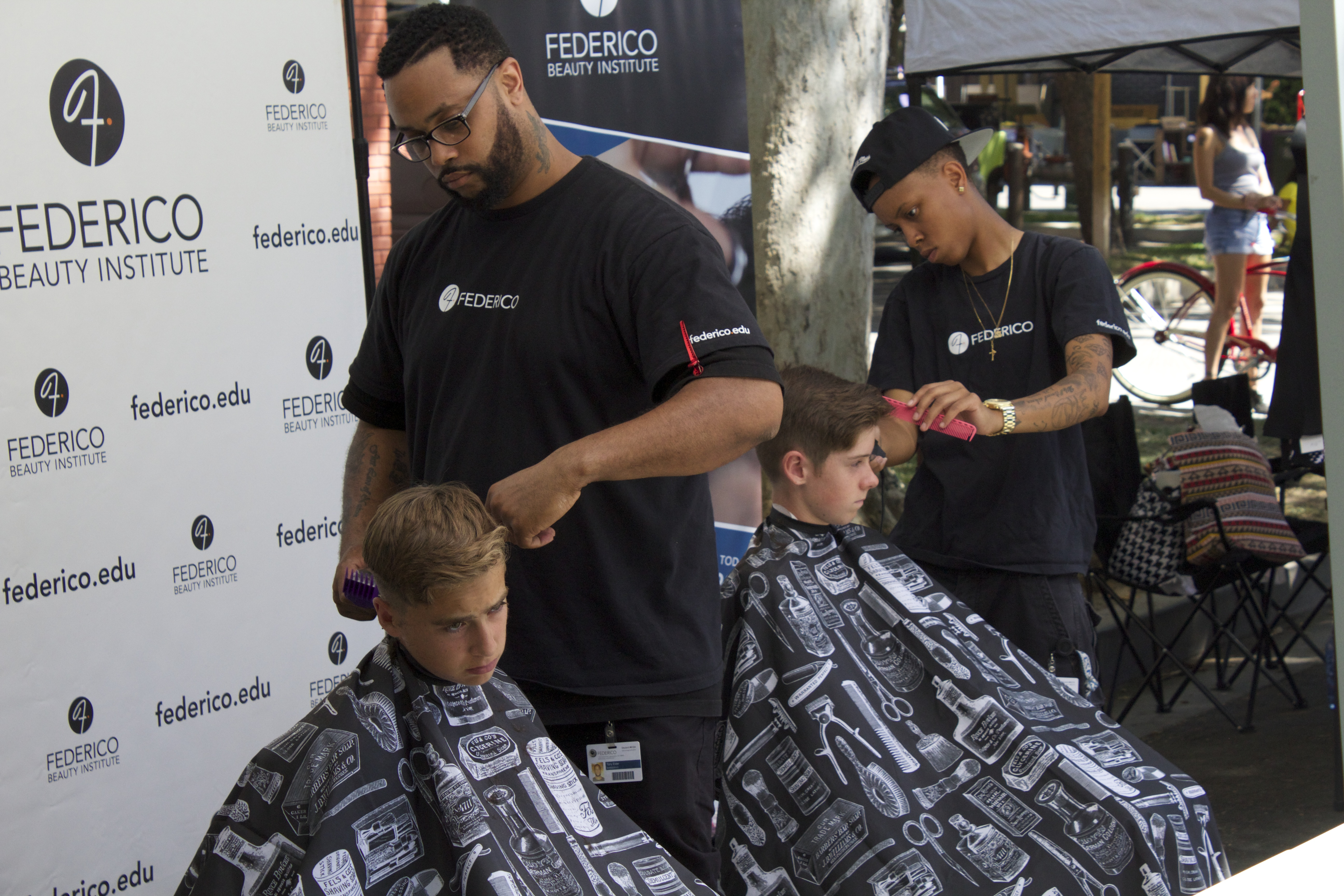 Barber students Keith Z. and Vee getting it done.