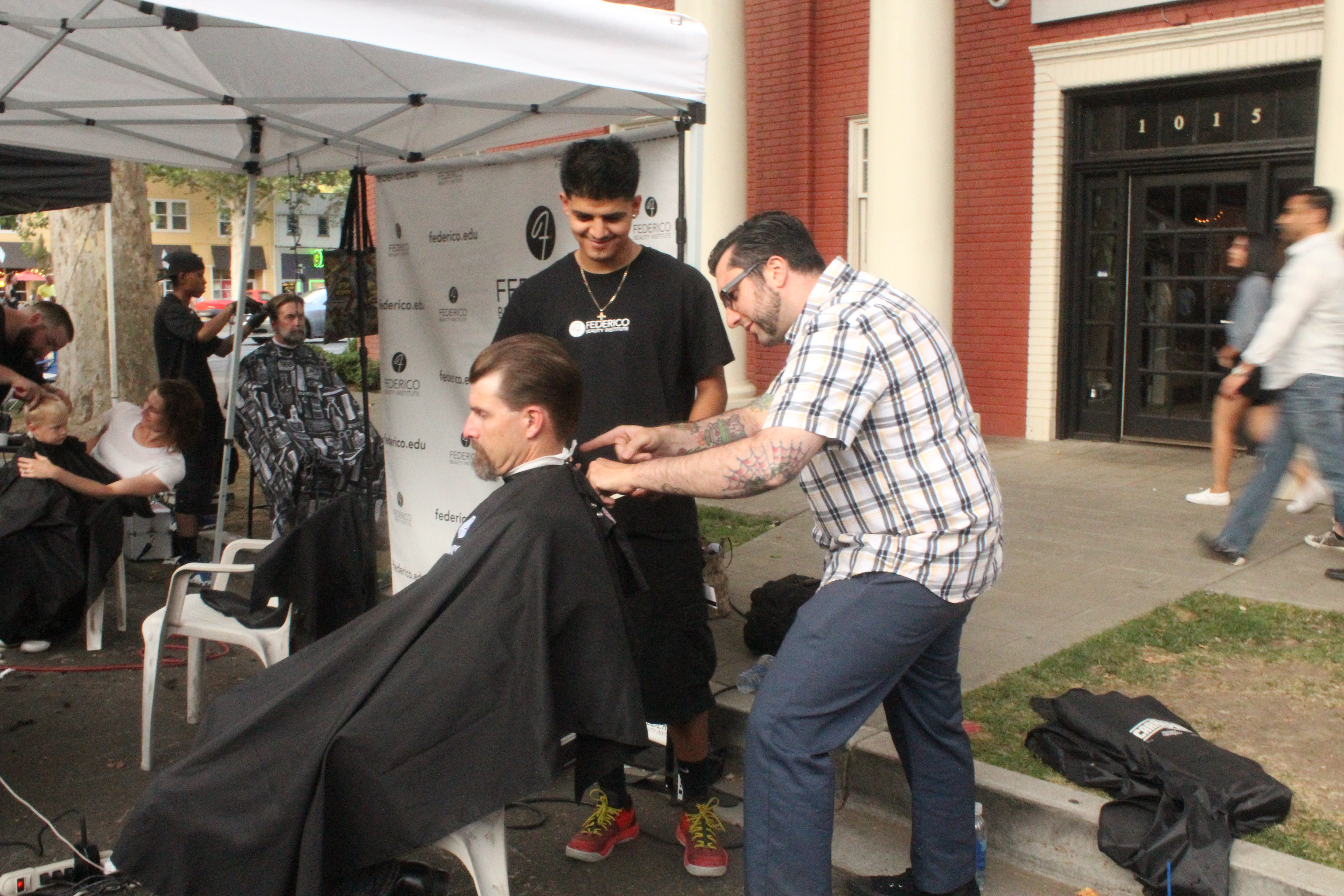 Barber instructor Zac cleaning up a line.