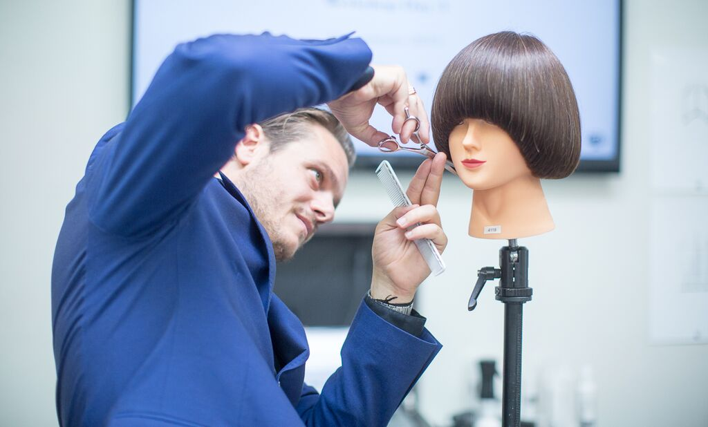 JB perfecting his cut