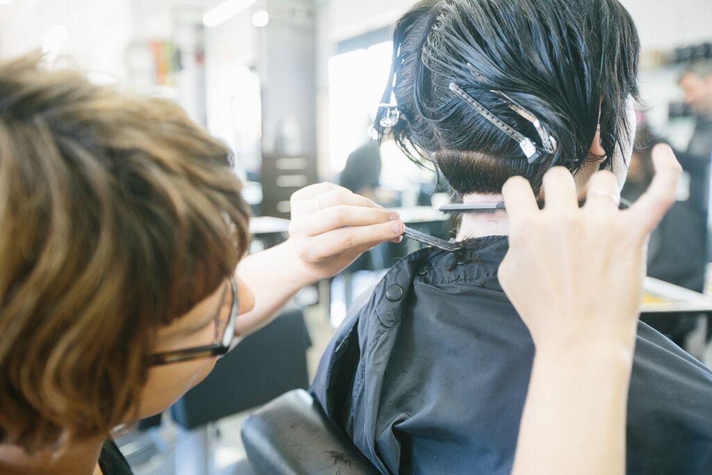 Caitlin Senna of AJF Academy working on her cut