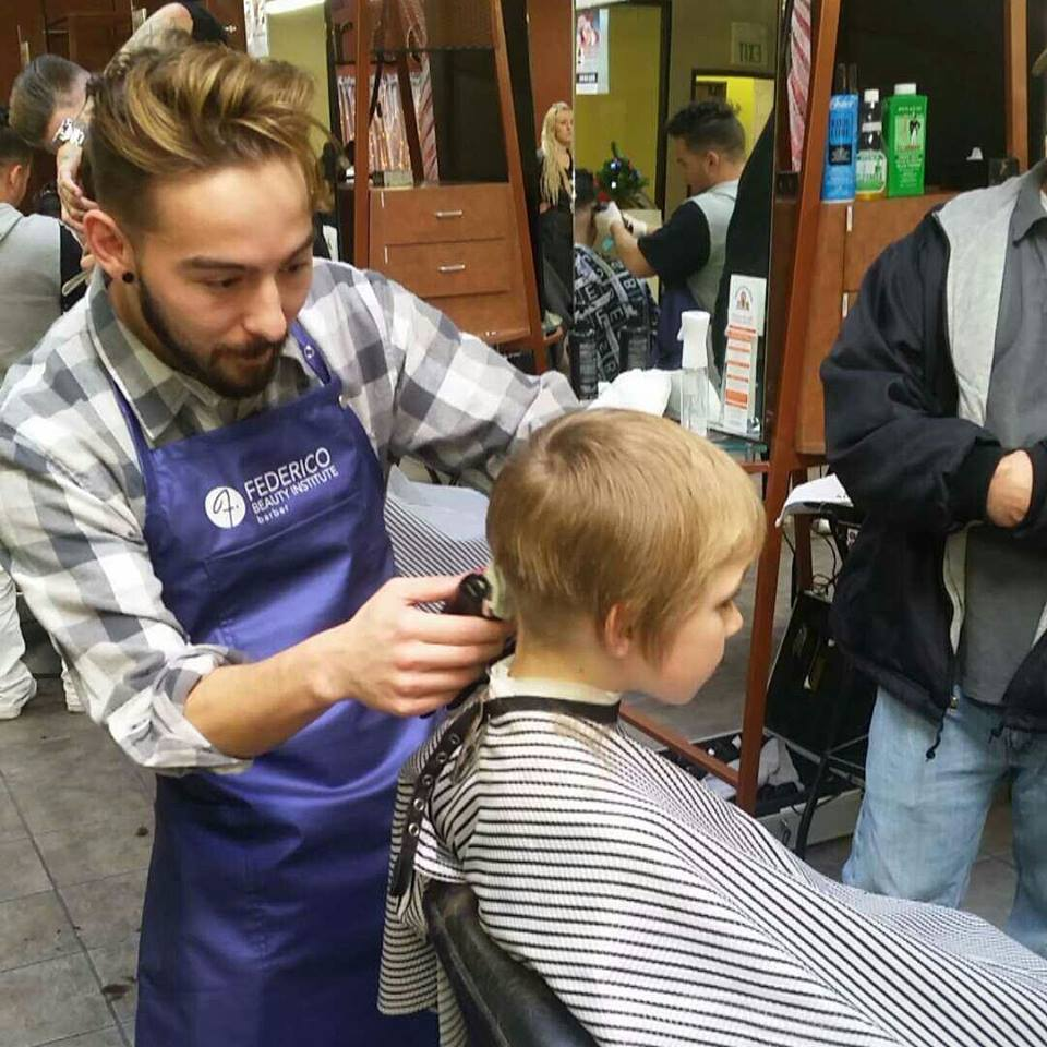 Child receiving a free haircut and a super cute hair style