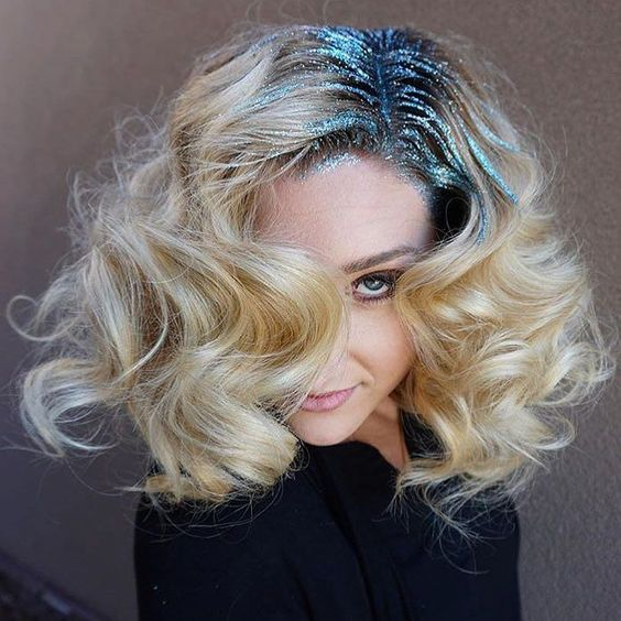 Model with a wavy long bob with glitter highlighting her part