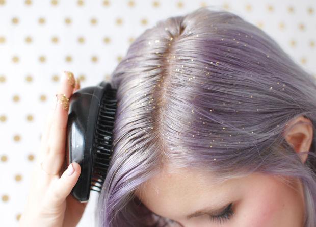 Model distributing glitter through her hair