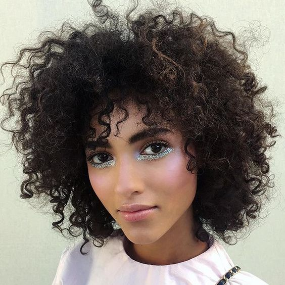 Model with glitter highlighting under her eyes
