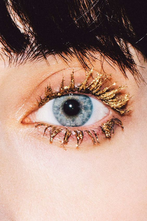 Glittery gold eyelashes