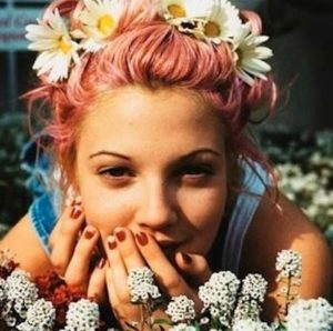 Drew Barrymore showing the flower crown style of the 90's