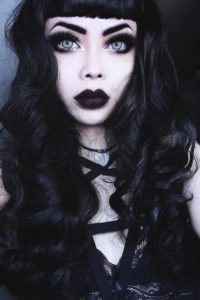 Goth model with accentuated eyes and big, dark lips.
