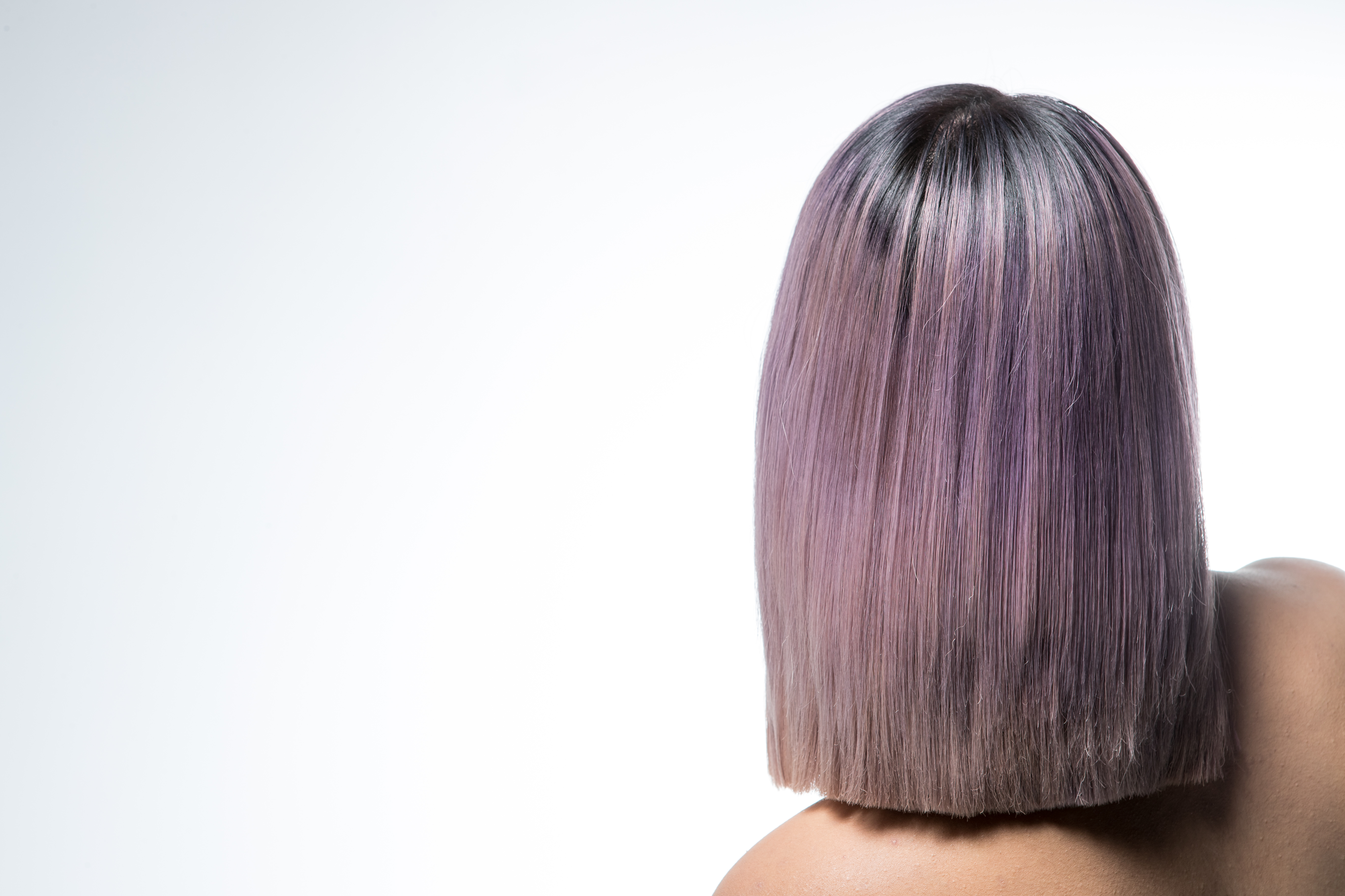 Back of a model with pastel-lilac bob
