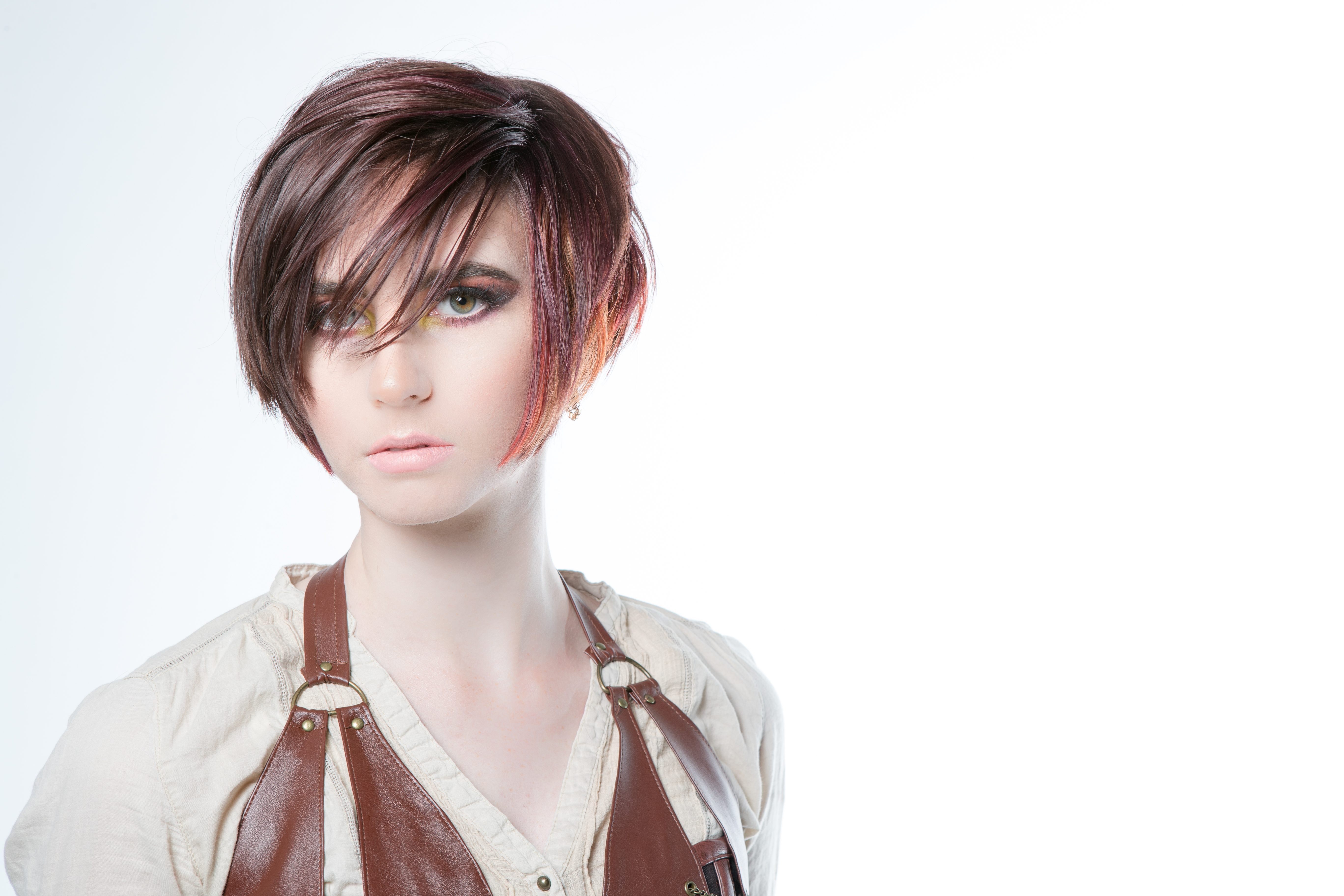 Model with a pixie cut that has orange highlights at the ends