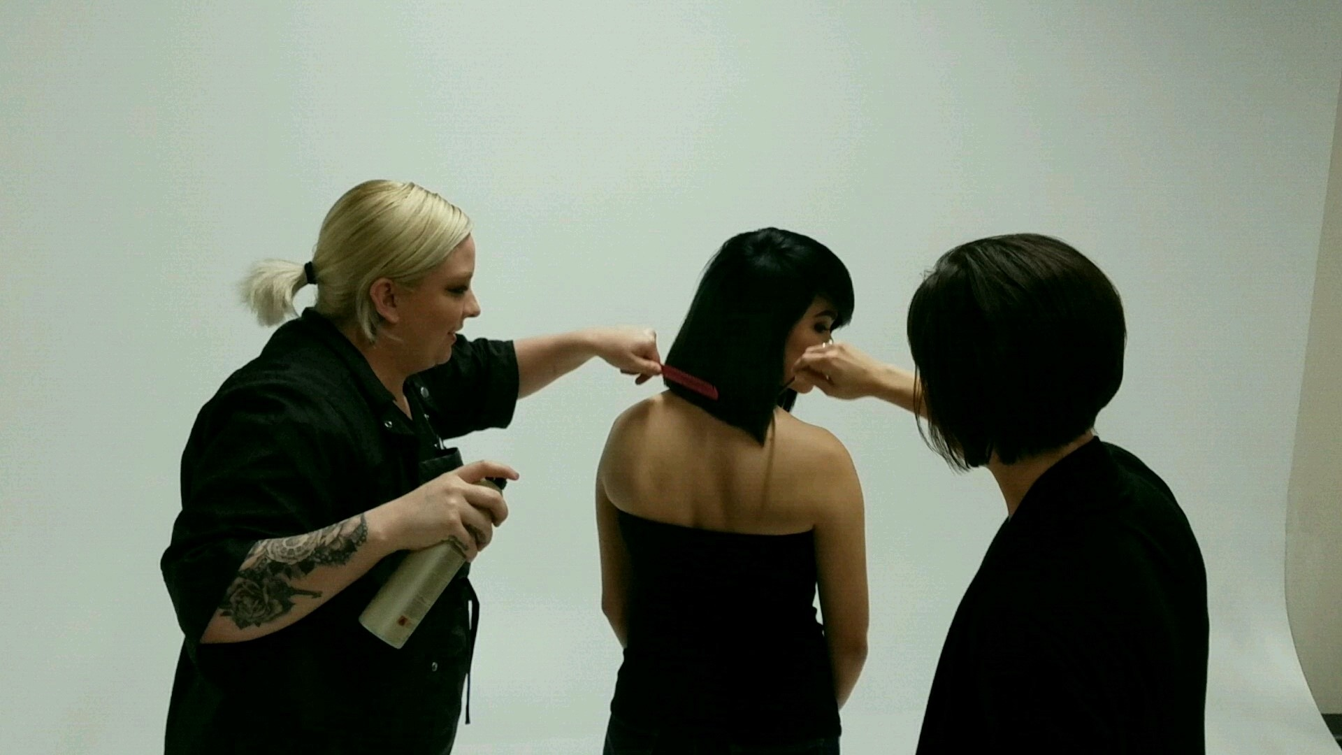The final preen before the model has a photo taken.