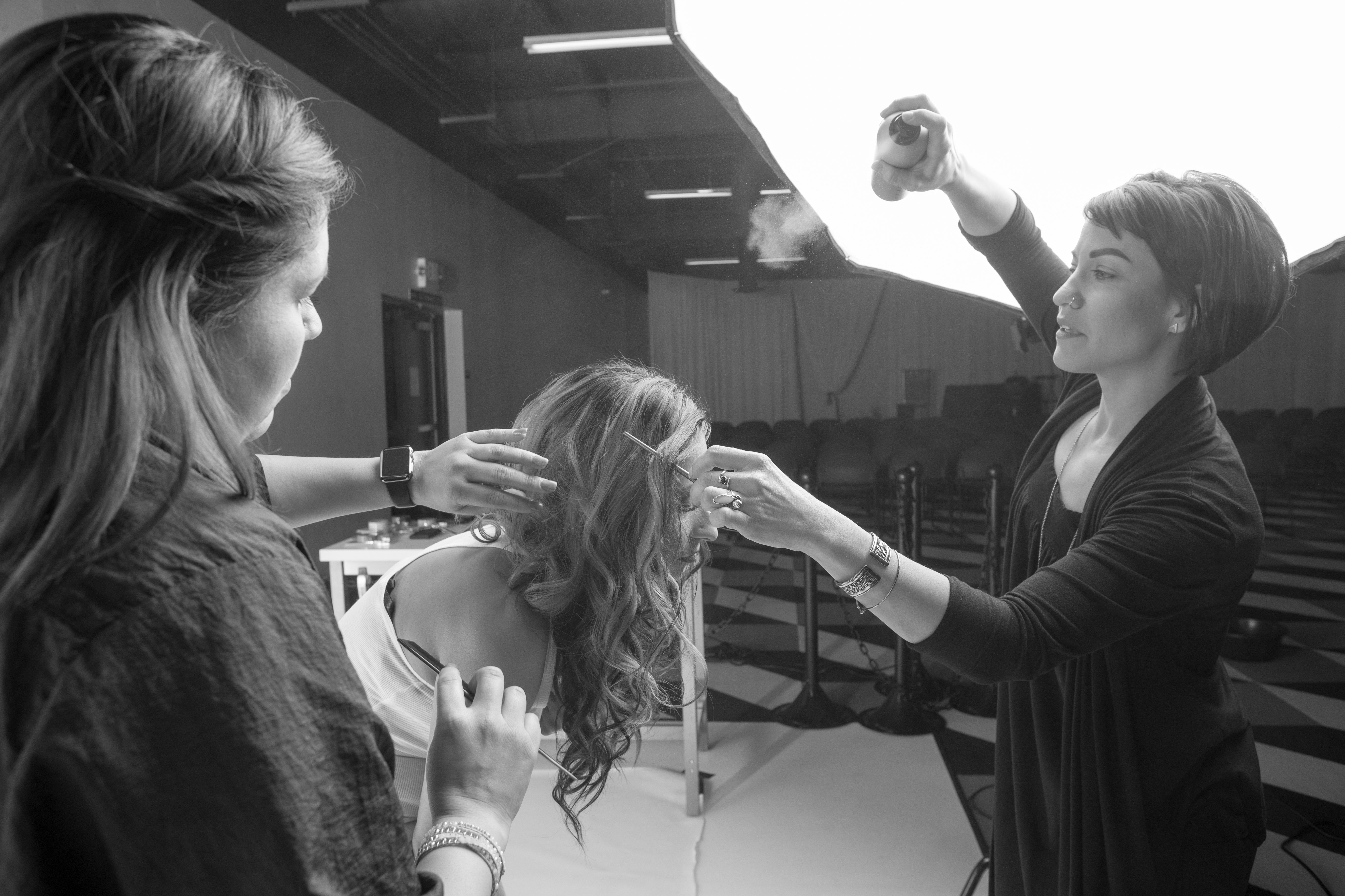 Prepping for the photo shoot, using lots of hairspray!
