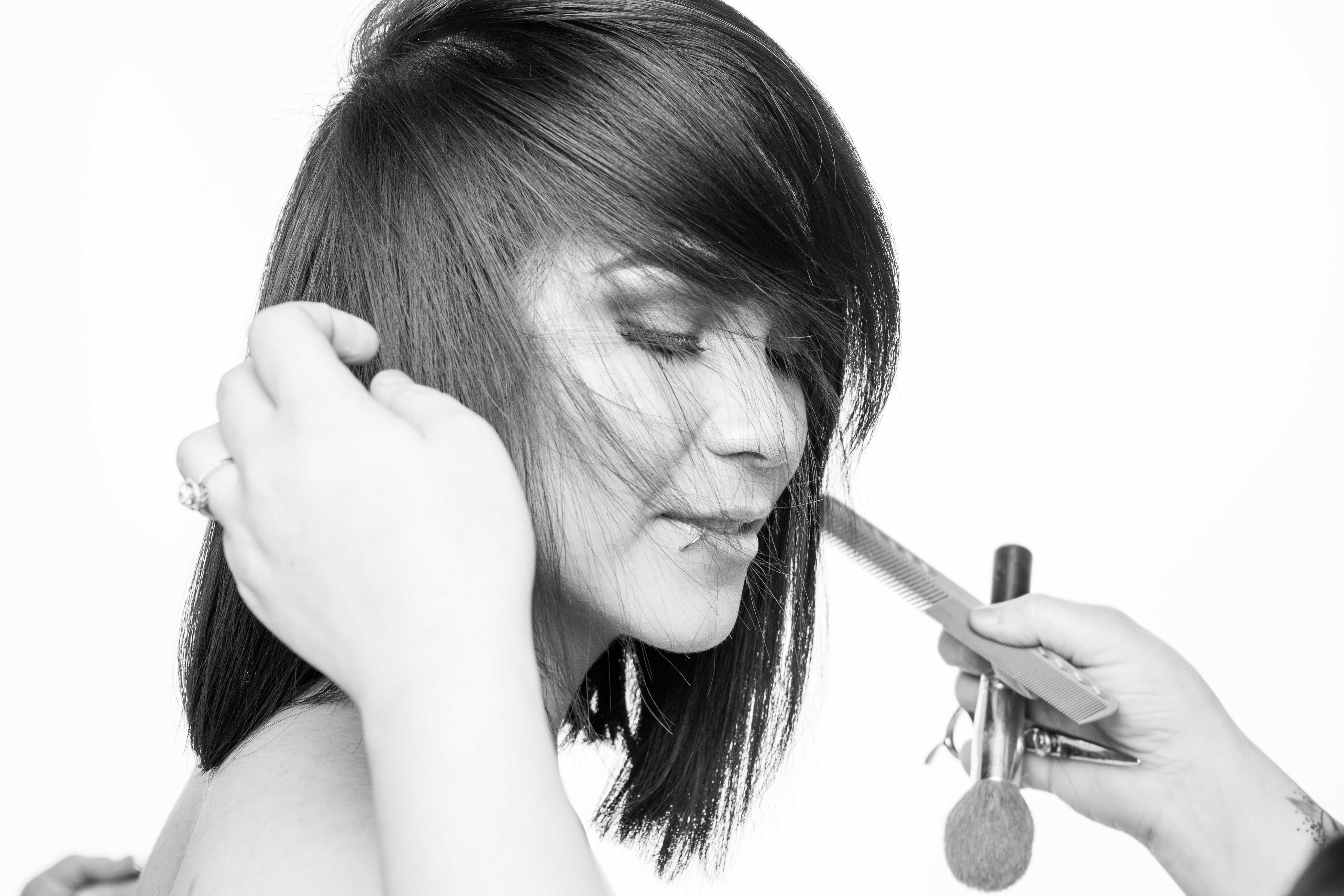 Getting a model's hair ready for a shoot.