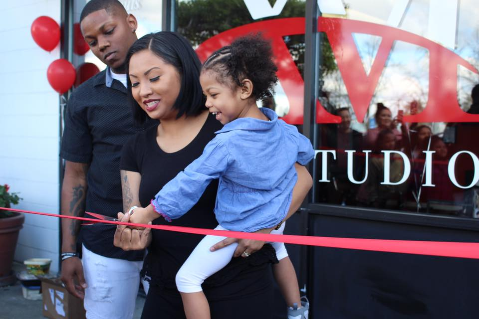 avier and Michelle White, the owners of XM Hair Studio at a ribbon cutting for their new studio