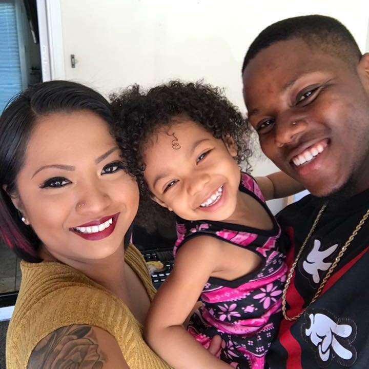 avier and Michelle White, the owners of XM Hair Studio with their child