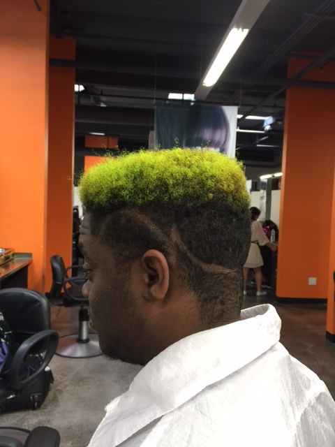 Neon lime hair on top.