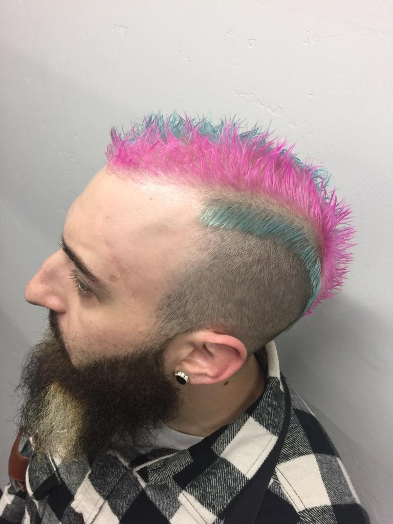 Pink and blue striped short mohawk.