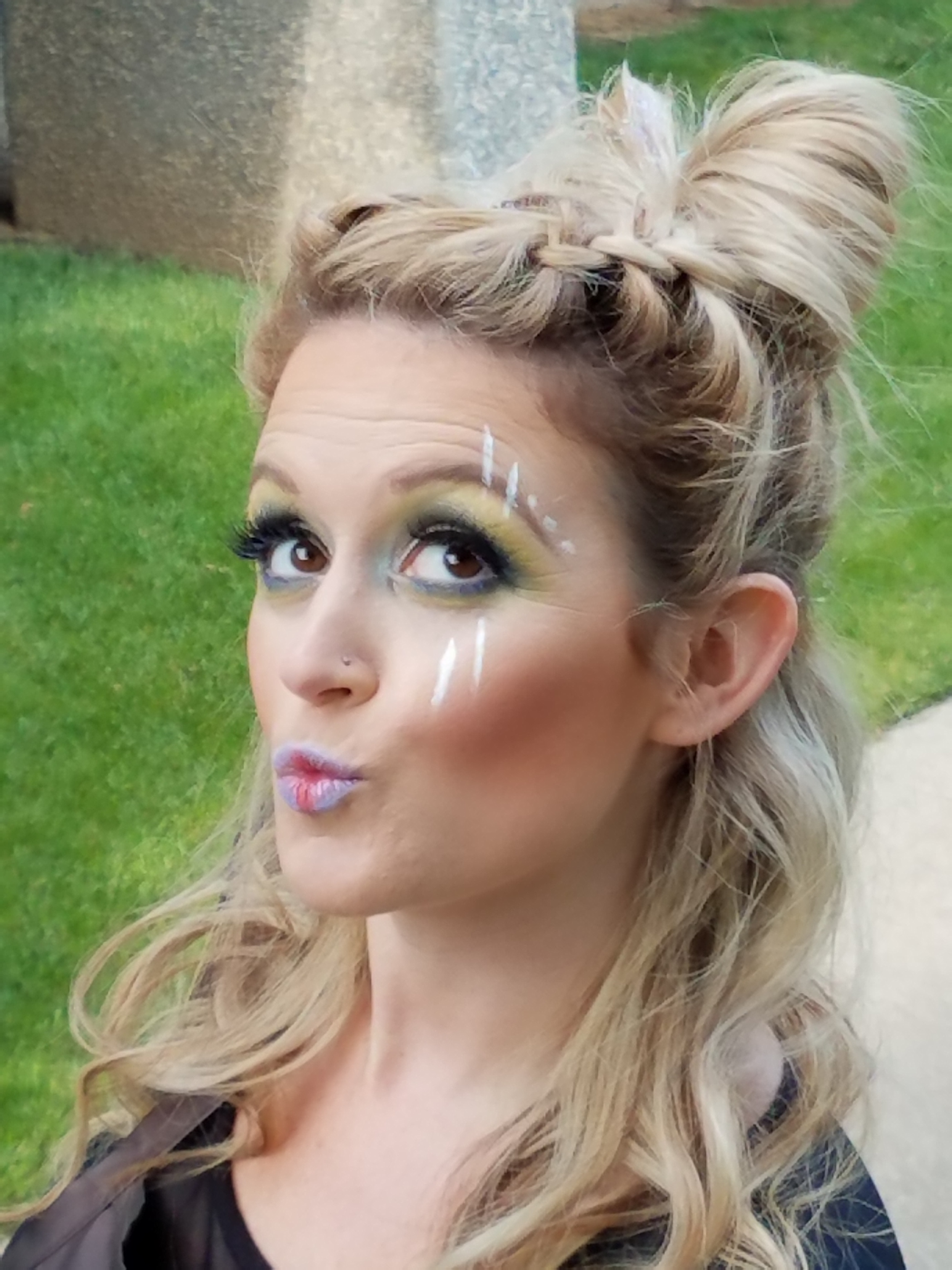 Cute festival up-do and fun makeup - complete with duck face!
