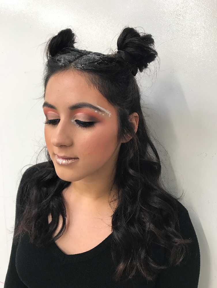 Showing off glittery festival makeup and hair.
